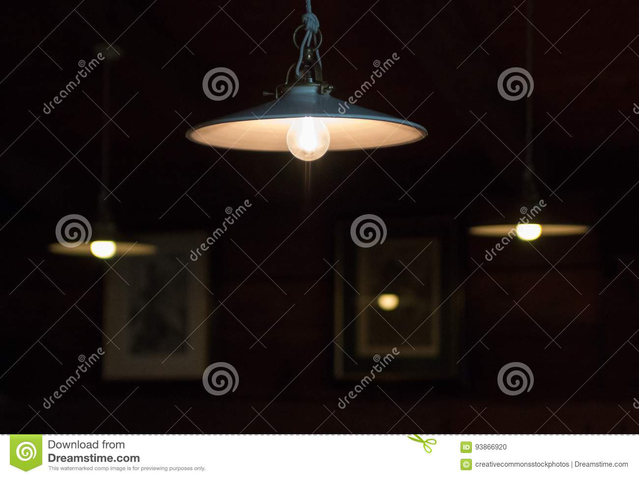 Hanging Light Fixtures Glowing Softly In The Darkness