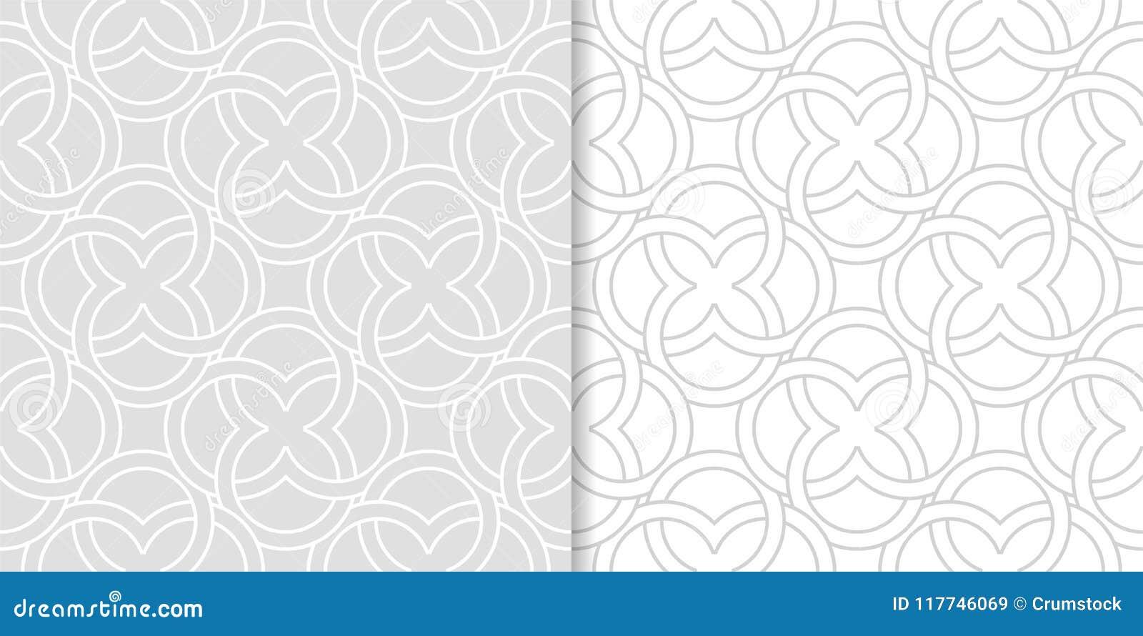 Light gray geometric ornaments. Set of seamless patterns