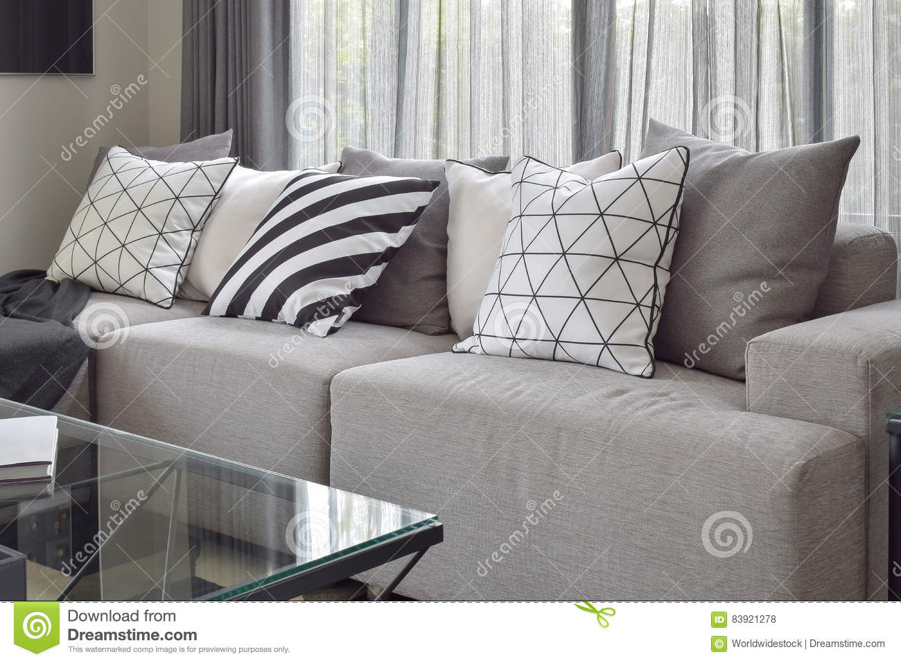Light Gray Sofa With Varies Pattern Pillows In Livling