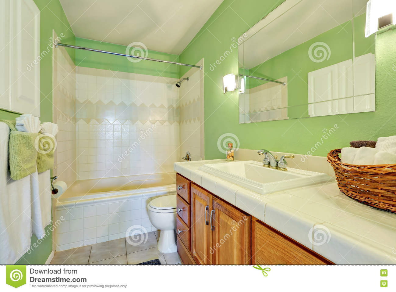 Light Green Bathroom Interior With White Tile Trim