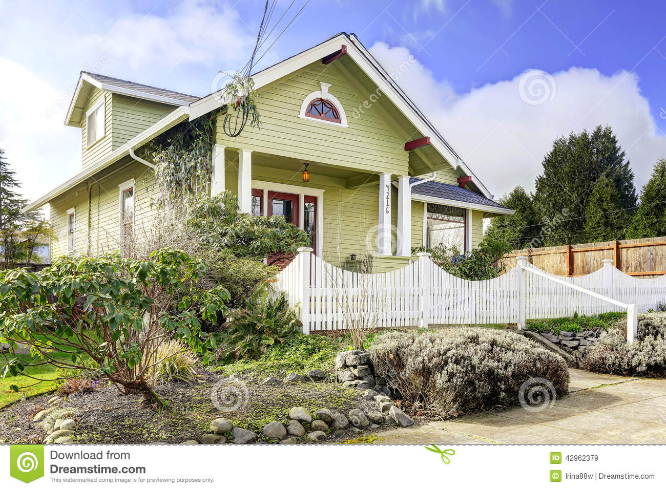 Light green house exterior with column porch and white for Casas pintadas exterior