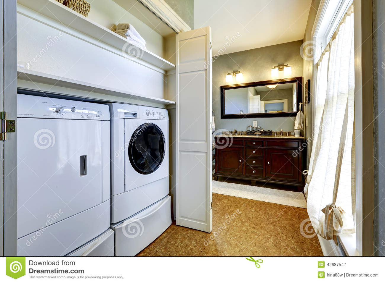 Light grey hallway with built-in washer and dryer