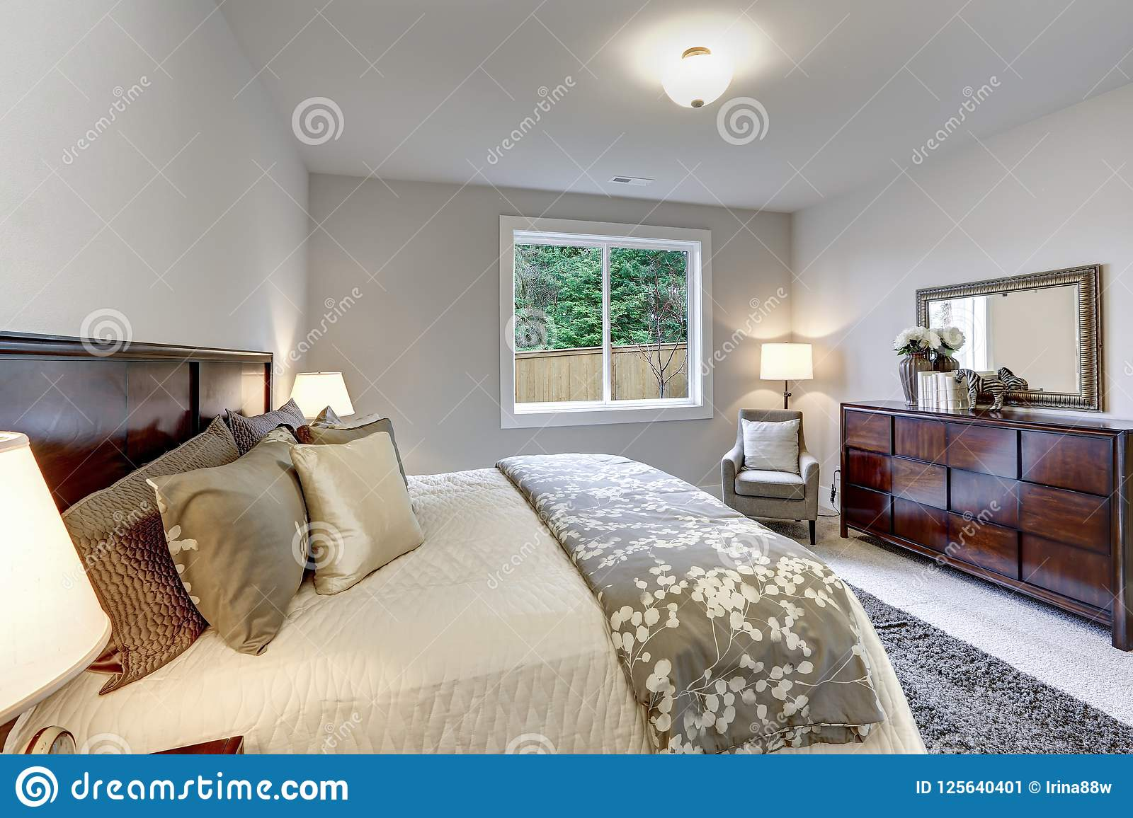 Light Modern Master Bedroom Interior With Dark Wood Bed And