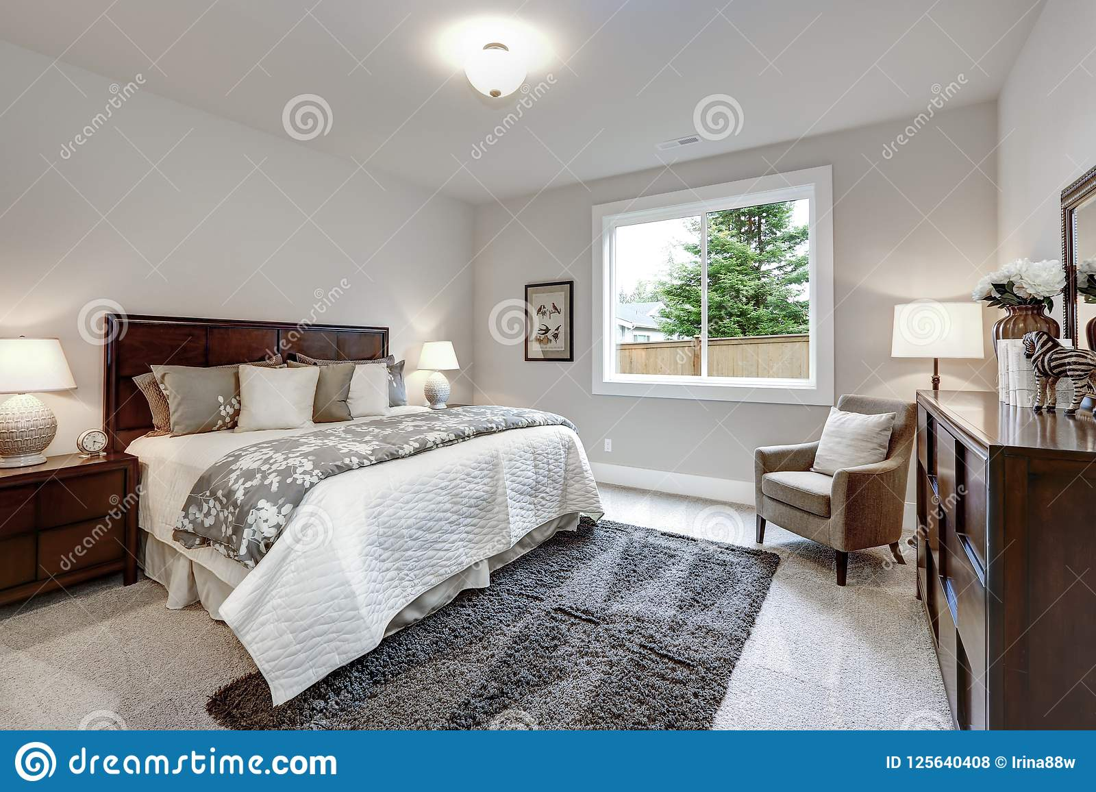 Light Modern Master Bedroom Interior With Darkwood Bed And ...