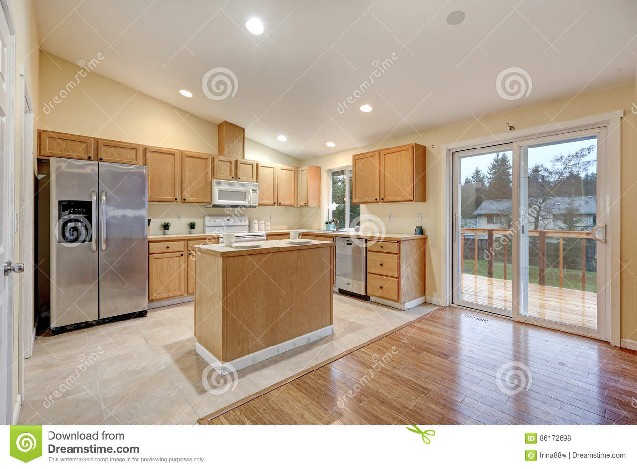 Light Open Concept Kitchen Room With Vaulted Ceiling Stock Photo