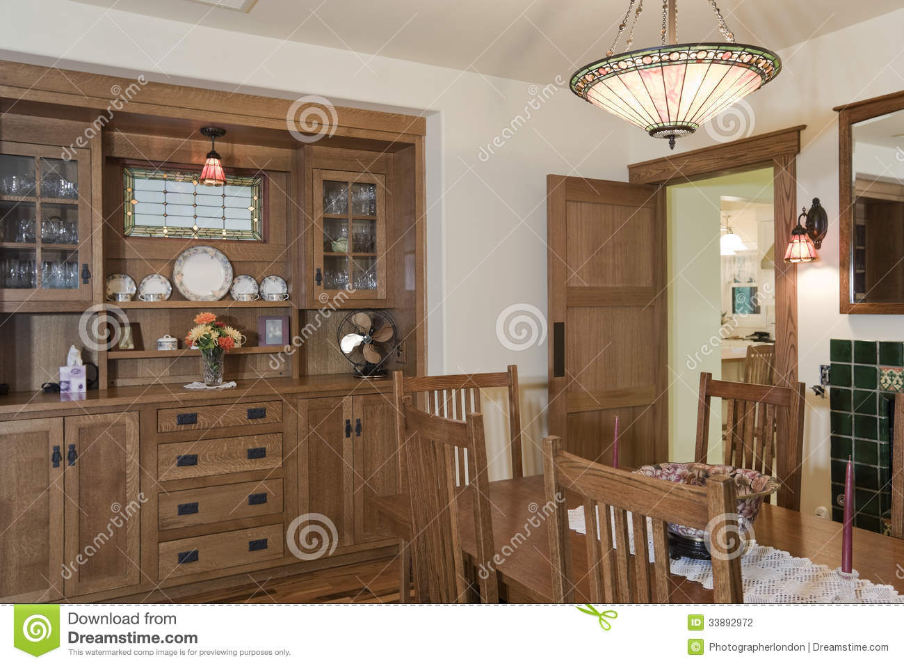 Light Over Dining Table With Wooden Shelf In Background