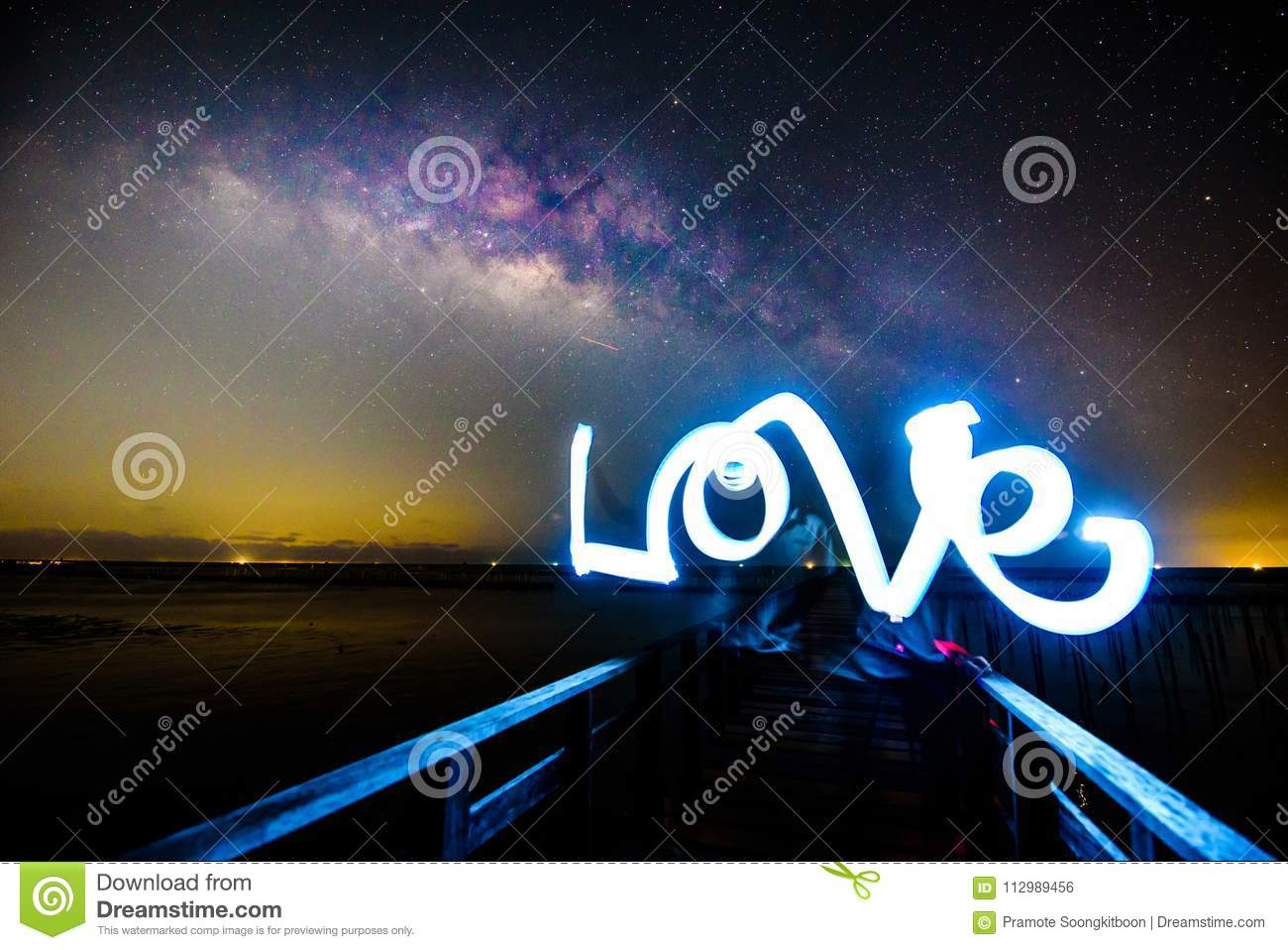 Light painting the LOVE word and milky way
