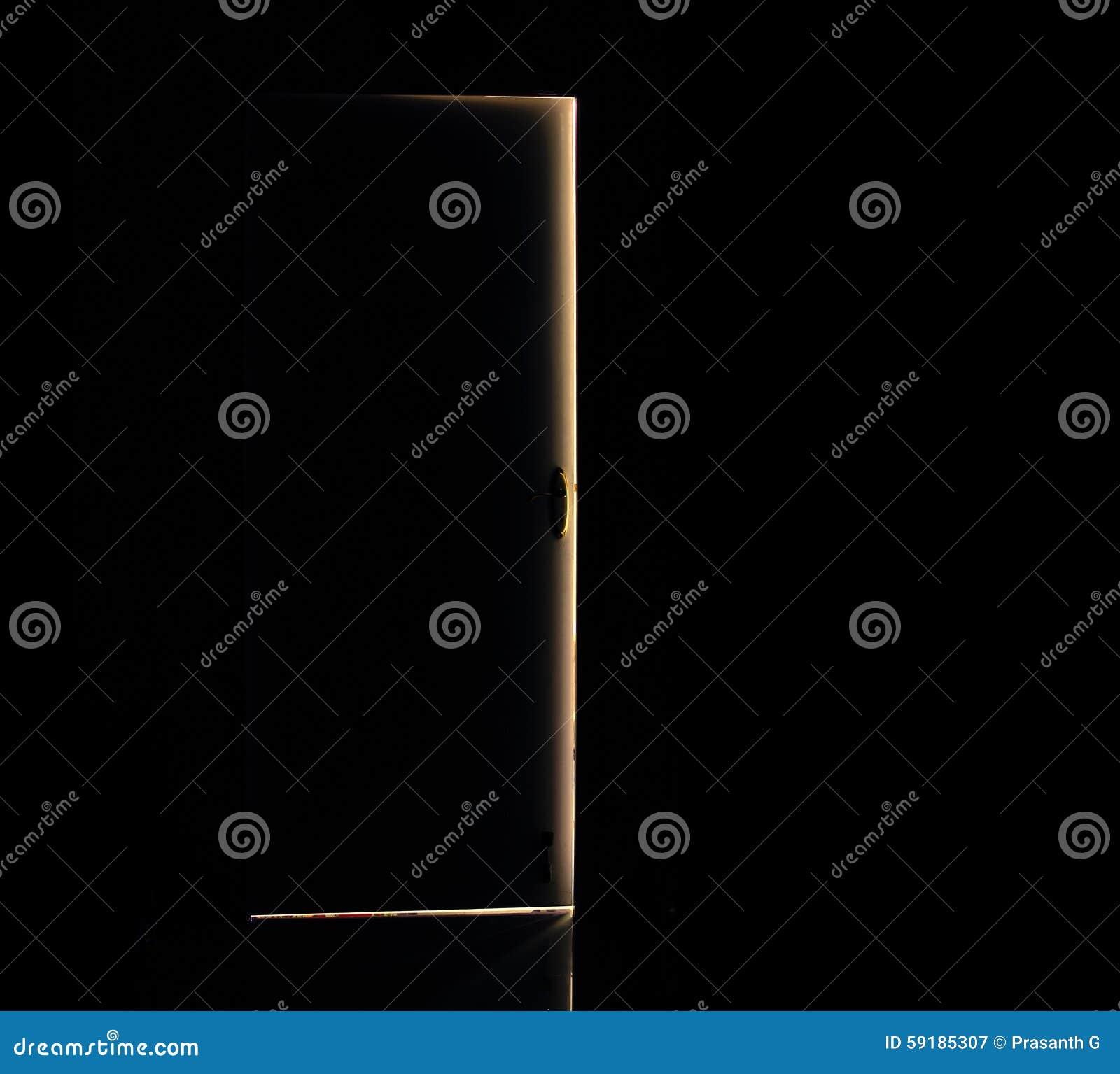 Open Door Dark Room light passing through open door of a dark room. stock photo