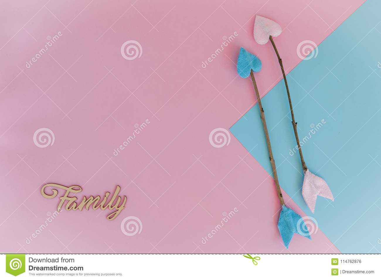 light pink blue background with twig arrows and wooden letters
