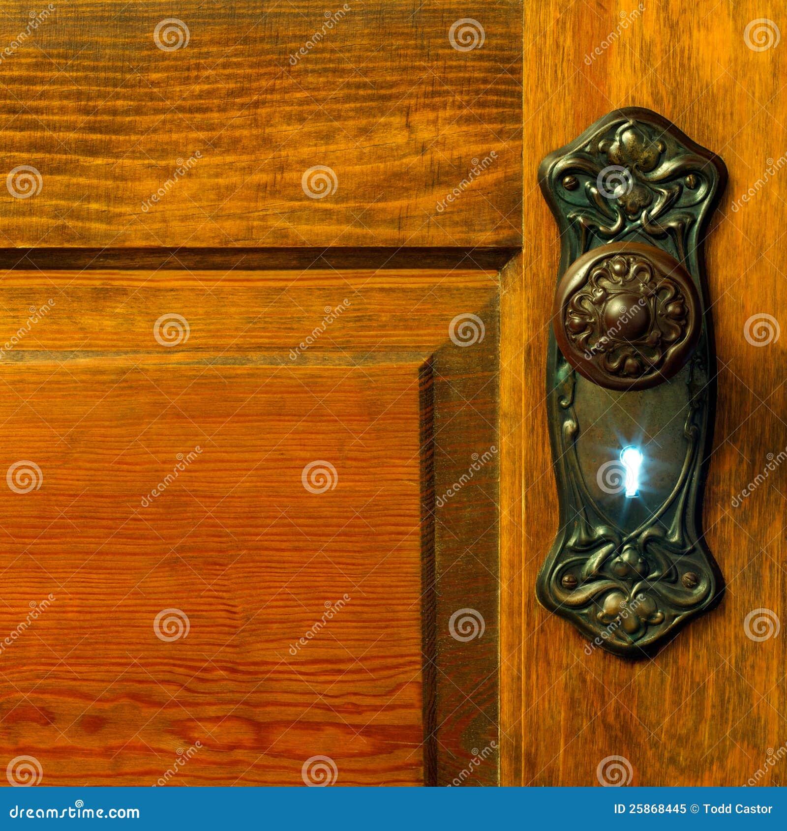 Light Shining Through Old Skeleton Keyhole Stock Image