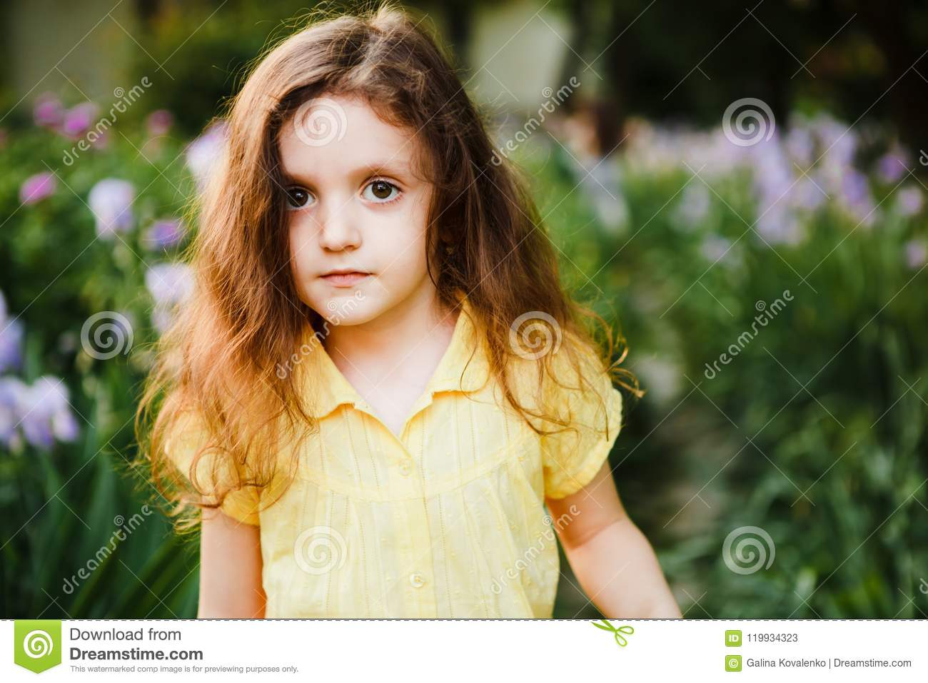 A Small Curly Girl In A Yellow Dress Stock Image Image Of