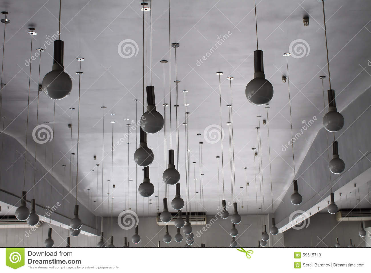 Light Store. Round Lamps On Wires Hanging From The Ceiling Stock ...