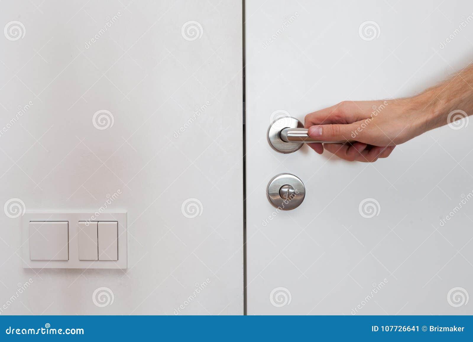 Light Switch Next To The Door Handle. Open White Door With Metallic ...
