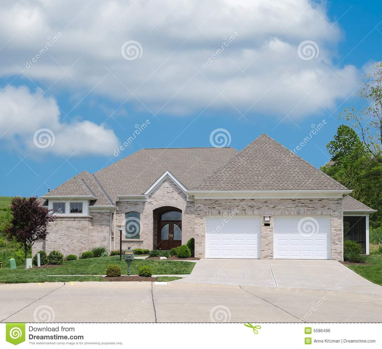 Light tan brick suburban home royalty free stock image for Home tanner