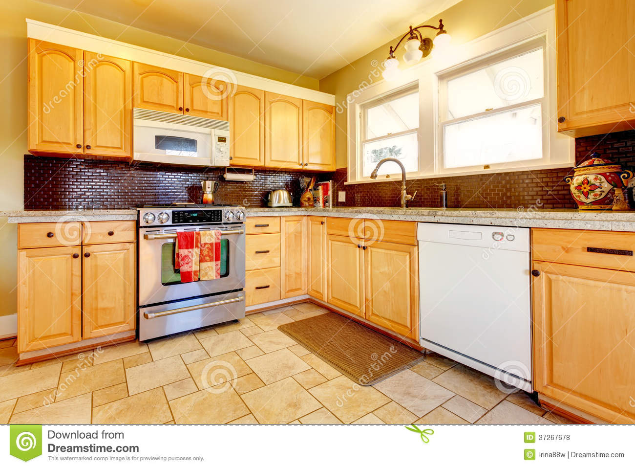 Light Yellow Kitchen Light Tones Wood Kitchen With Brick Backsplash Design Royalty Free