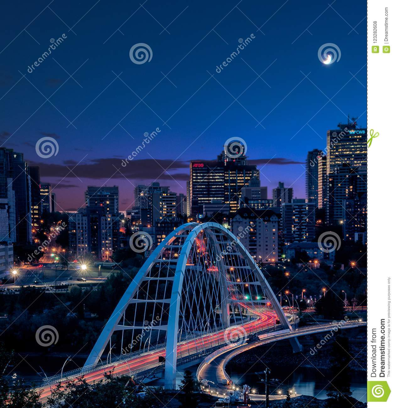 Light trails as traffic goes across the new bridge during blue hour in Edmonton YEG, Alberta , Canada
