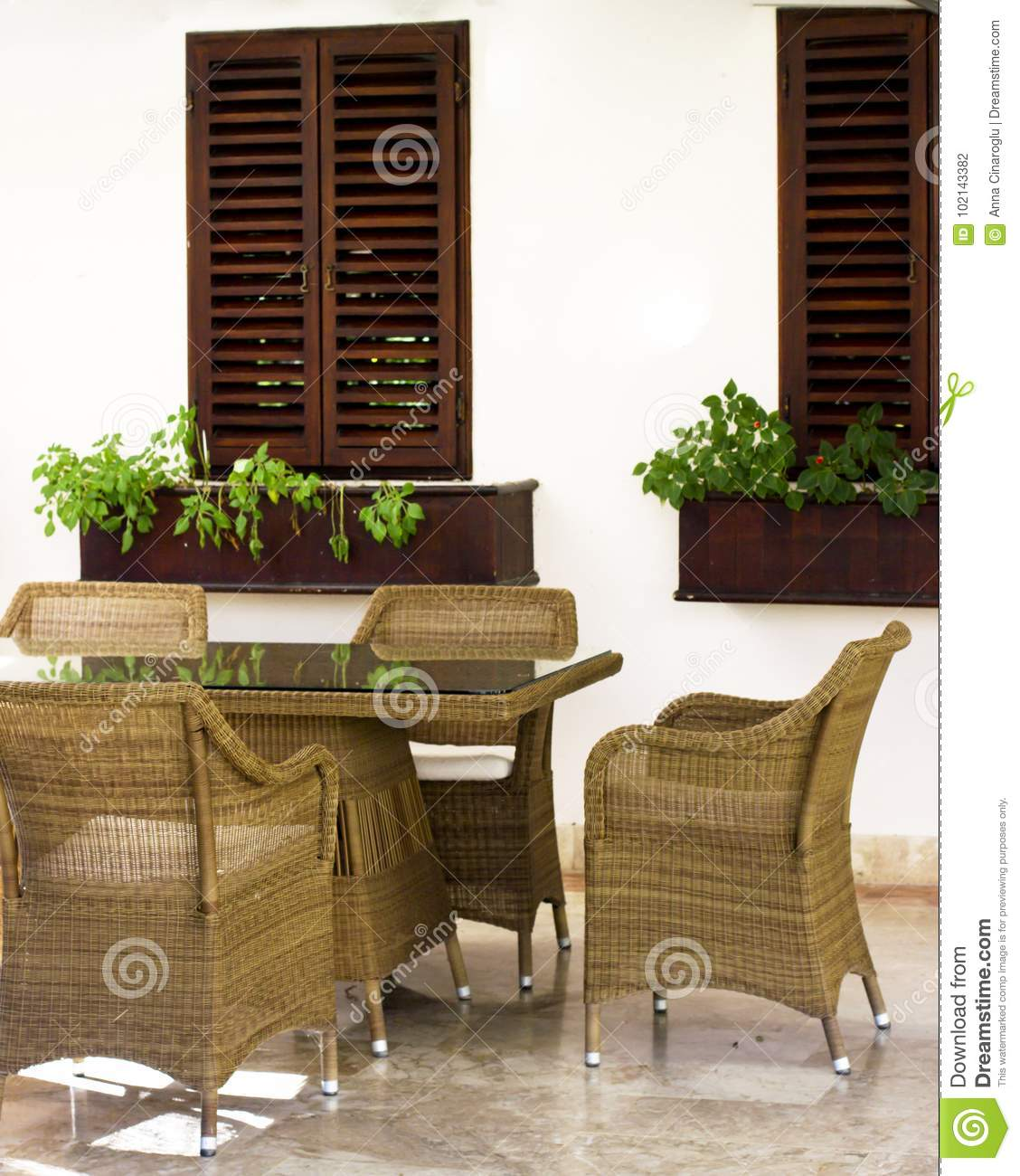 Brown Wooden Shutters : Light wall with dark brown wooden shutters and