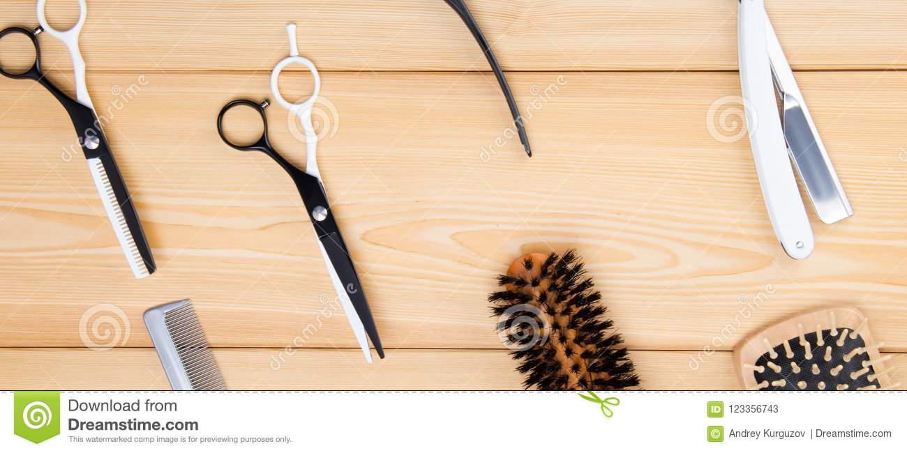 light wooden background, are objects for cutting hair and beard and styling, combs.
