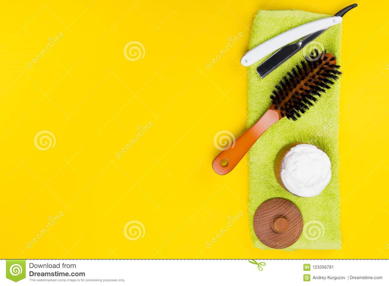 on a light yellow background, lie objects to create. beautiful beards, scissors, shaving foam and brush.