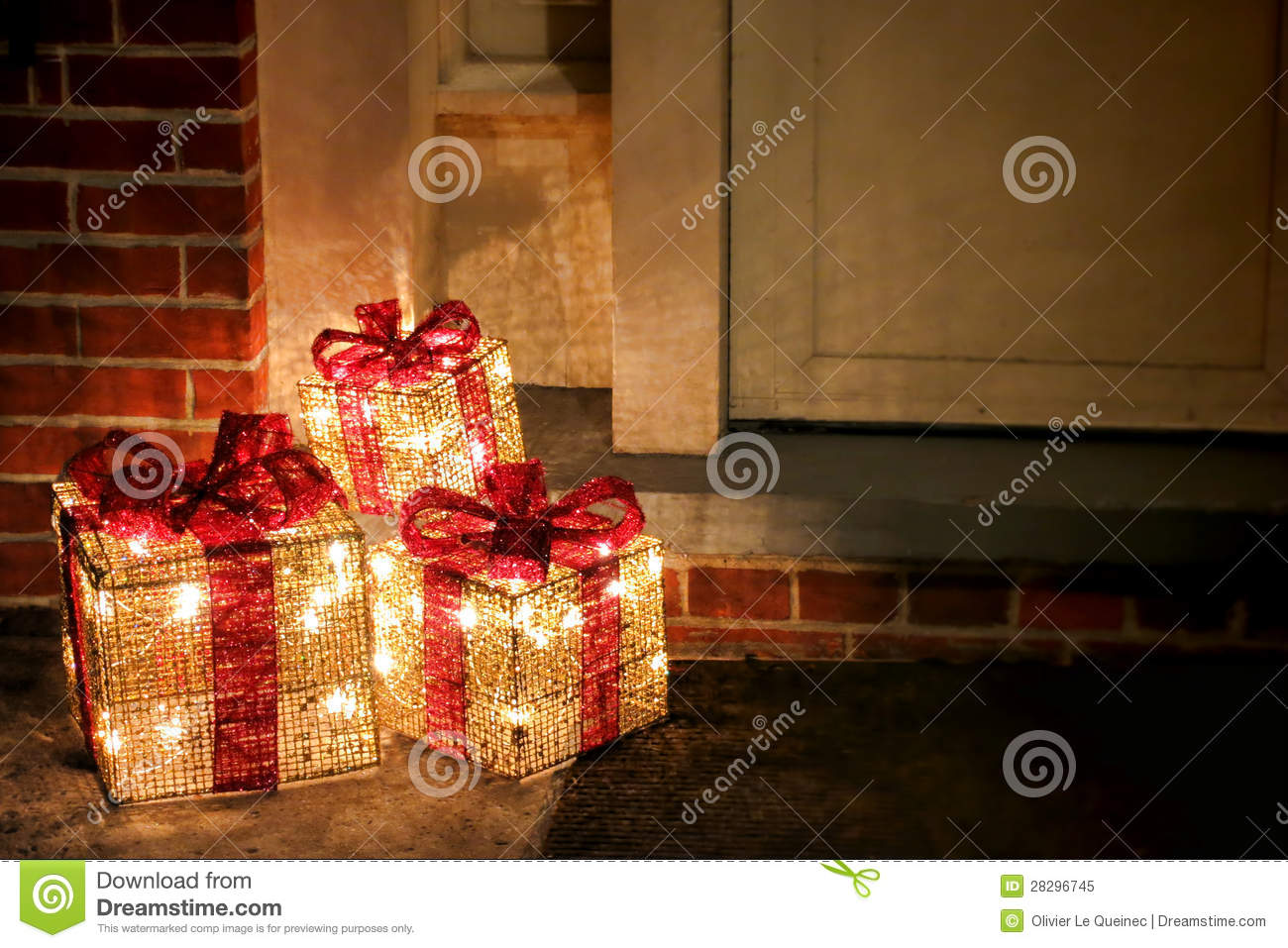 lighted decorated christmas gifts boxes at doorway stock - Outdoor Christmas Decorations Gift Boxes
