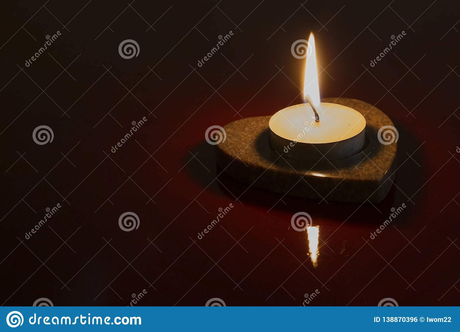 Burning candle in a dark
