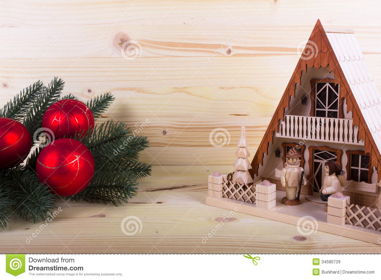 Lighthouse With Christmas Balls And Light Colored Wooden Background