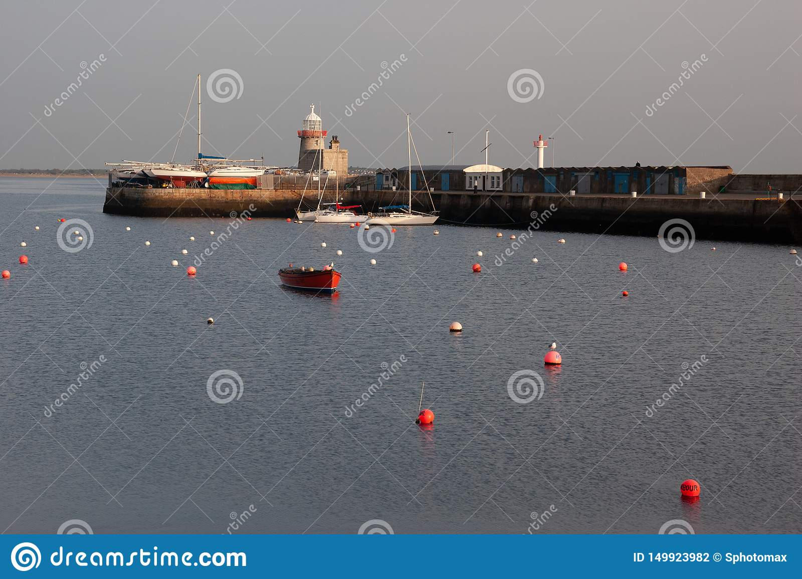 Lighthouse at Howth port. Howth is a fishing small port near Dublin Bay.