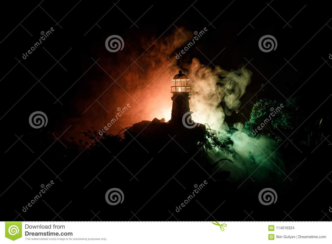 Lighthouse With Light Beam At Night With Fog Old Lighthouse