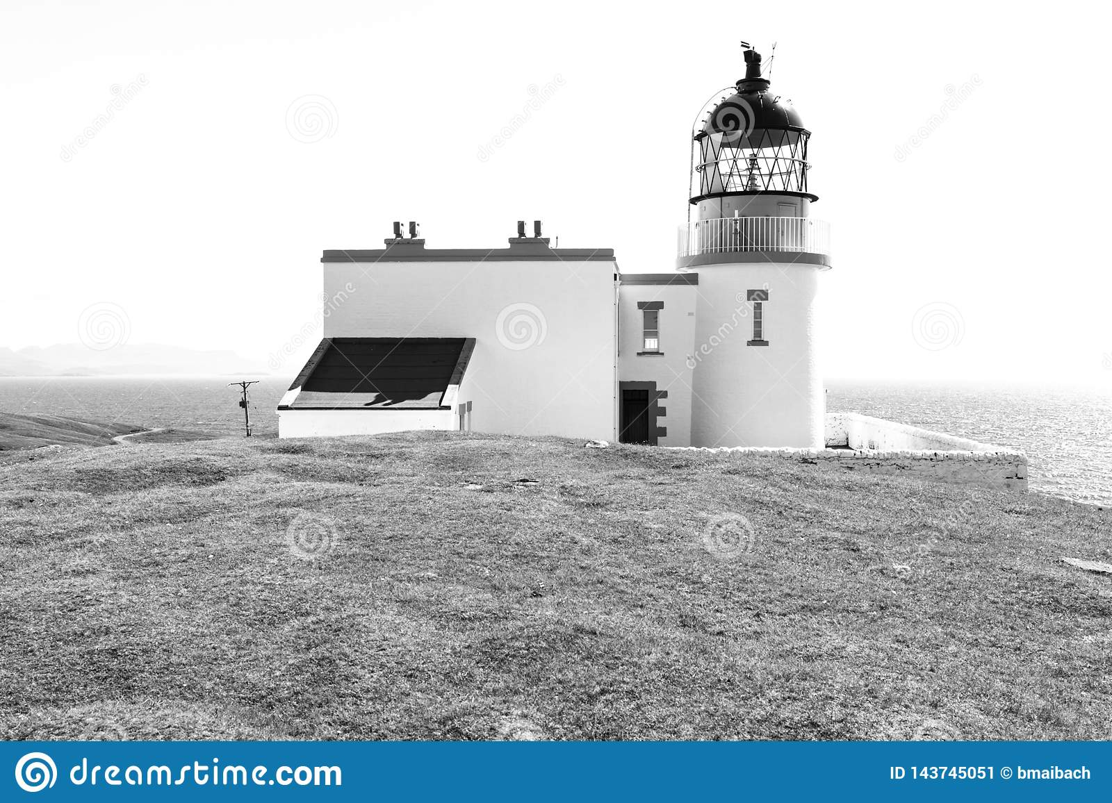Lighthouse with sea in black and white