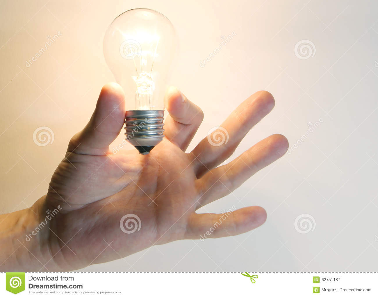 Lighting Lamp Flashing Bulb In Human Hand Stock Photography 62751284