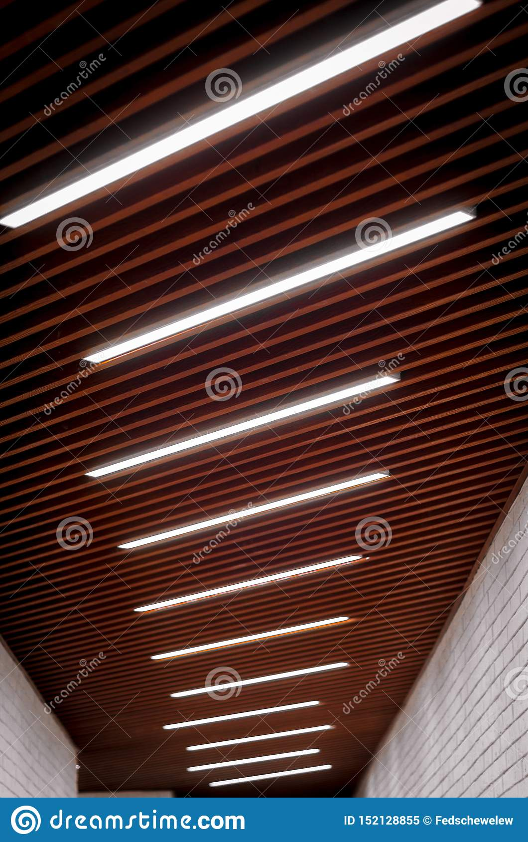 Lighting lamps on the ceiling in the corridor