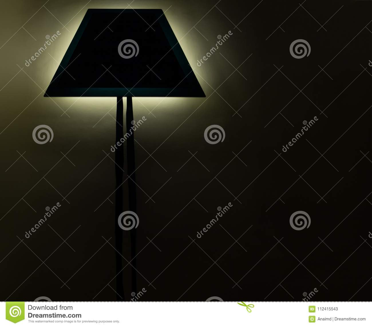 Lighting from modern elegant sconce on a wall in darkness