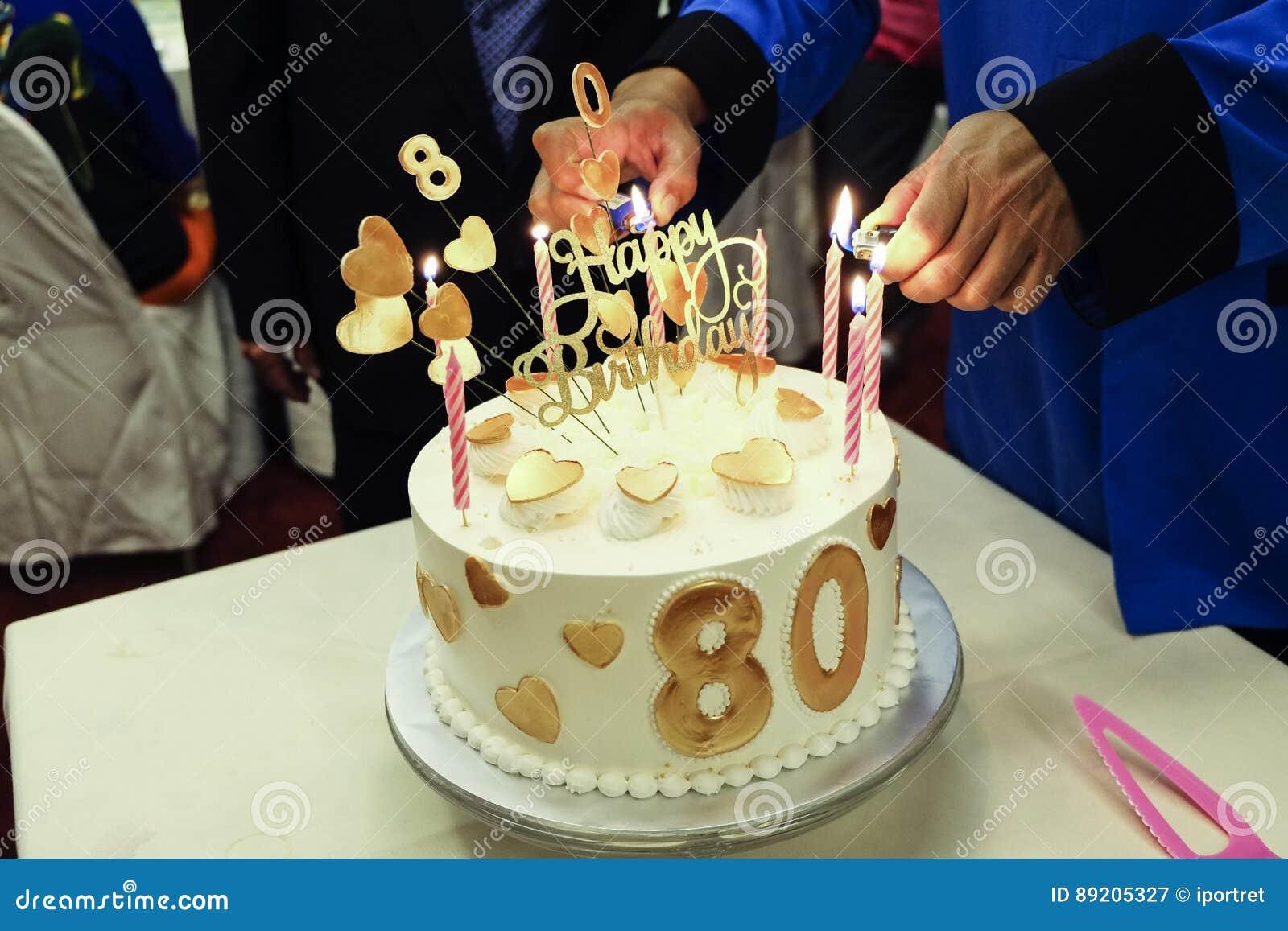 Lighting Up Candles On Birthday Cake