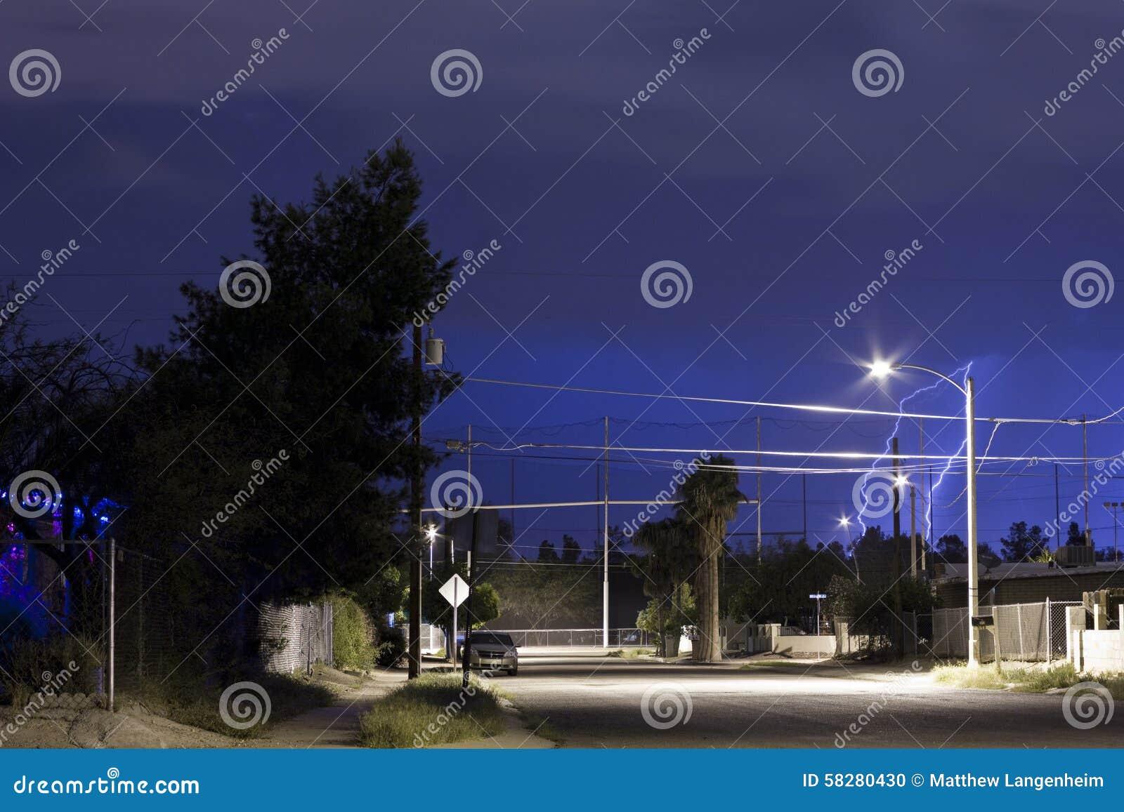 lightning over tucson az neighborhood at night time stock photo