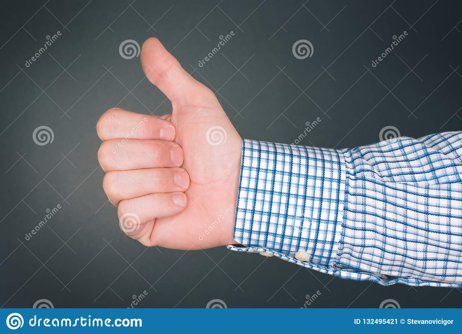 Like and approve hand gesture with thumb up