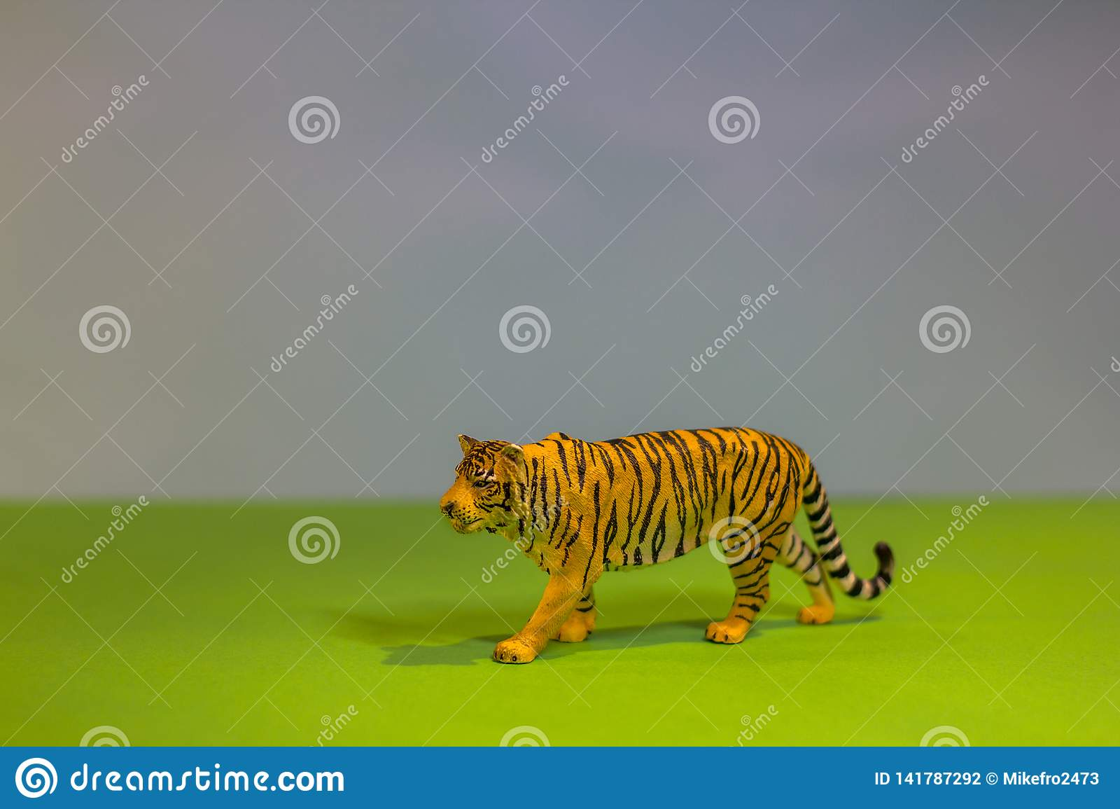 Like a real tiger. Toy tiger on a bright studio background. Eco toys.