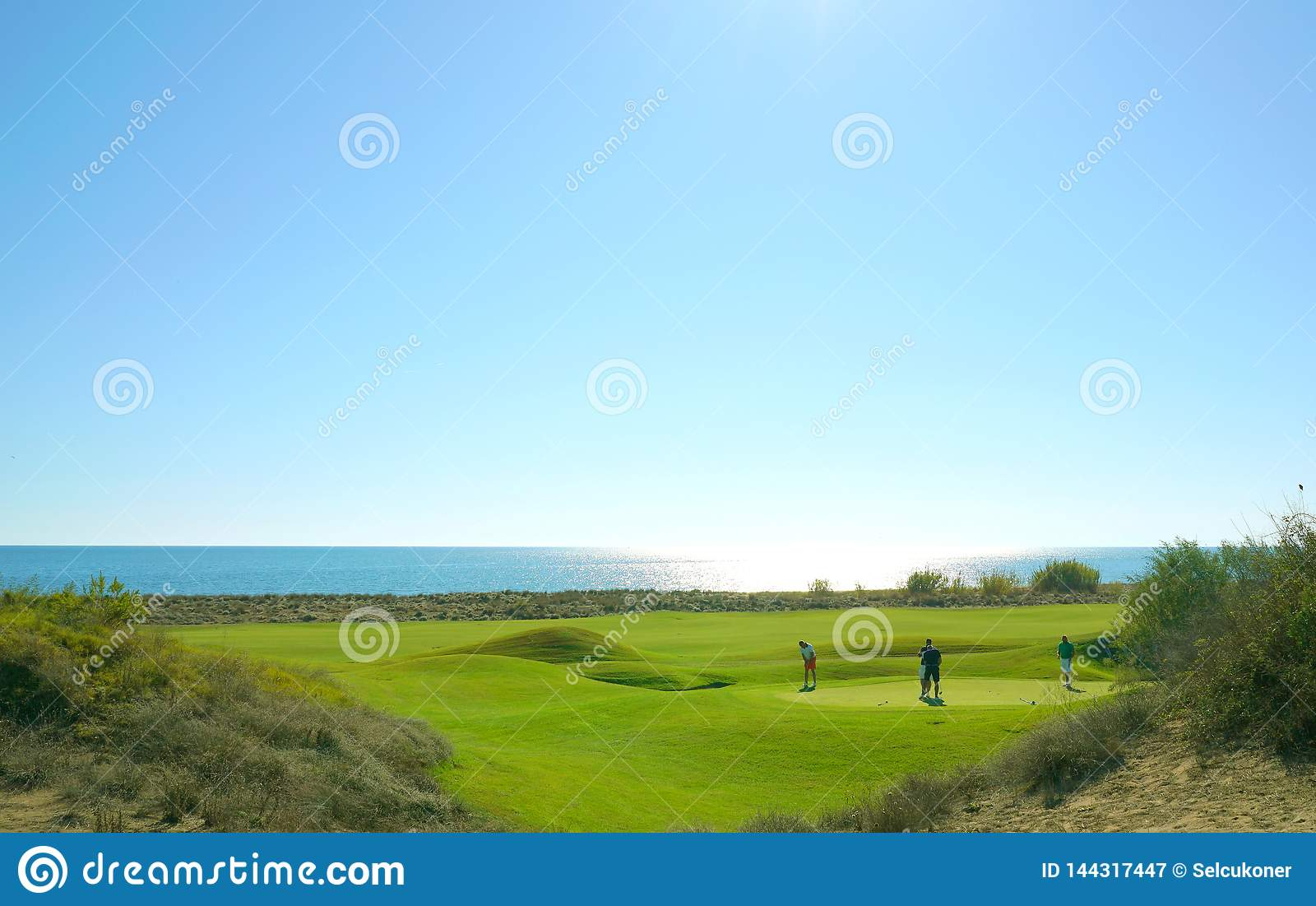 Golf players are enjoying Likya Links Golf course at sunny day in  Antalya