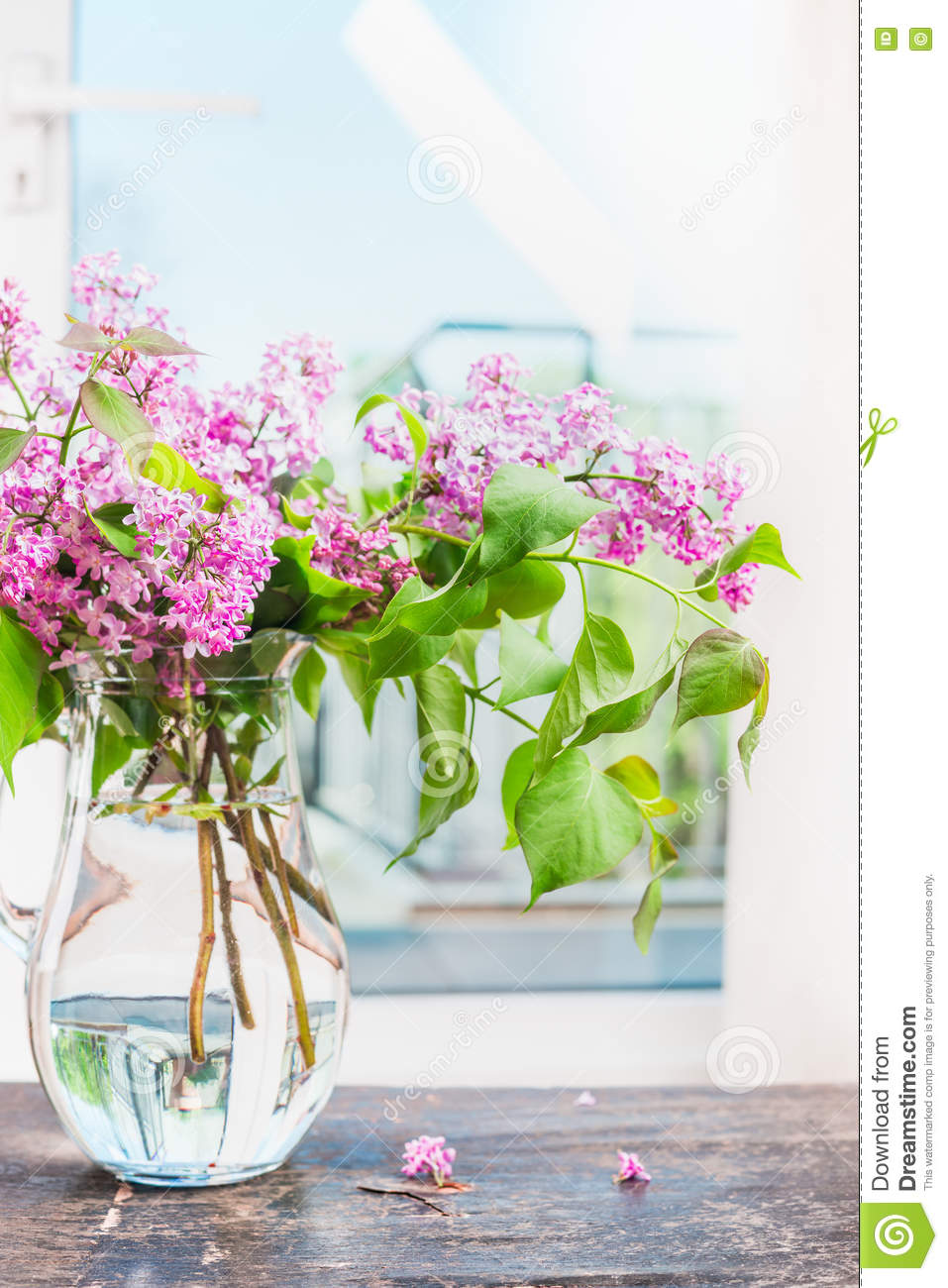 Lilac Flowers Bunch In Glass Vase On Window Still Stock