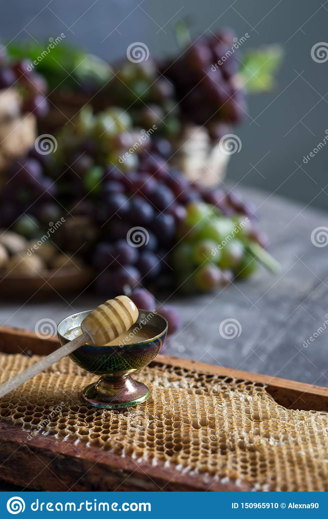 Lilac and green bunches of grapes and fresh sweet honey