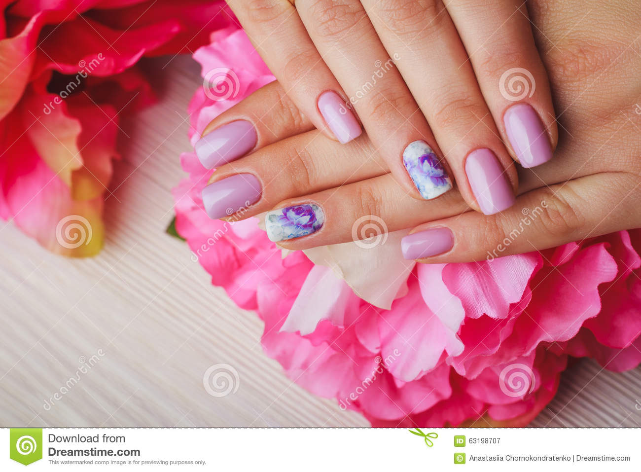 Lilac Nail Art With Printed Flowers On Light Background Stock Image