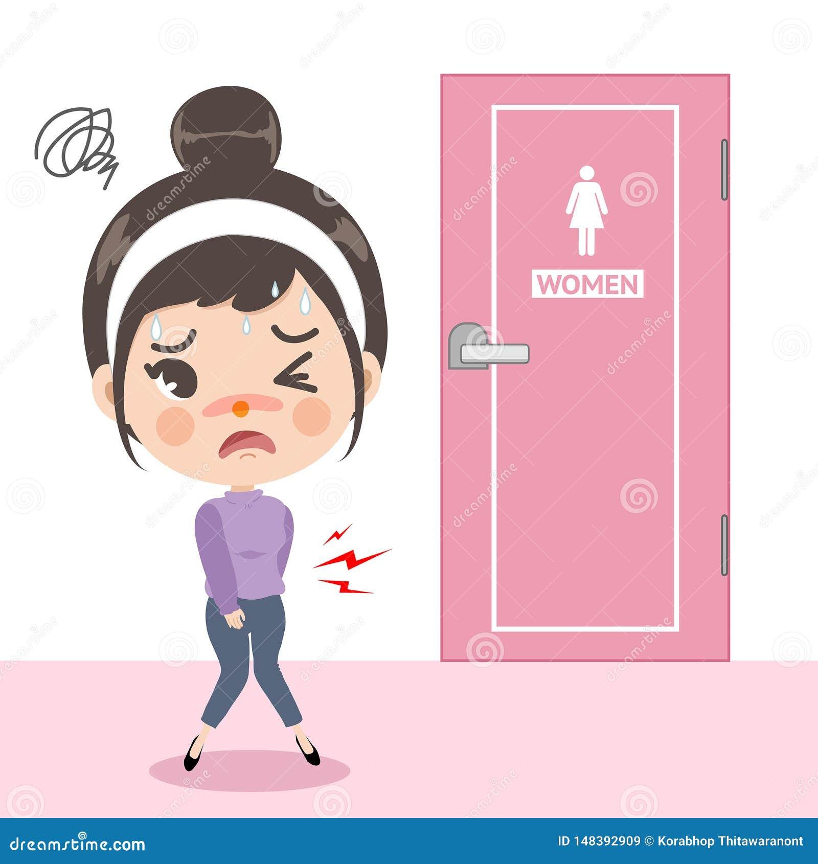 Lilla flickan klädde med filt en mageknip framme av toaletten