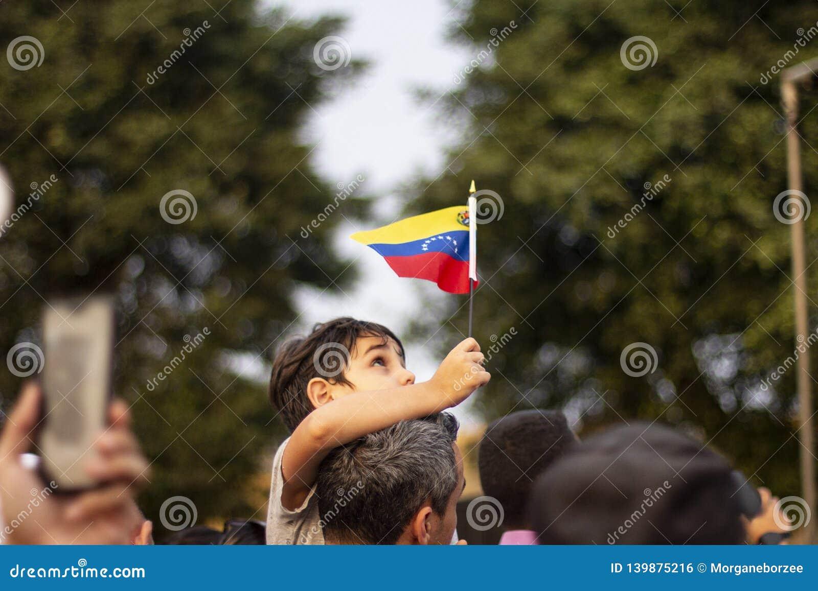Lima, Lima / Peru - February 2 2019: Kid holding Venezuelan flag in protest against Nicolas Maduro
