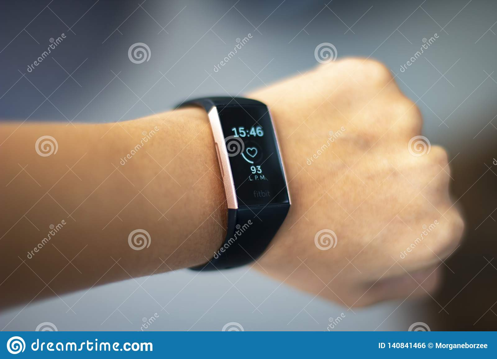 Woman monitoring her heart beat with a fitbit