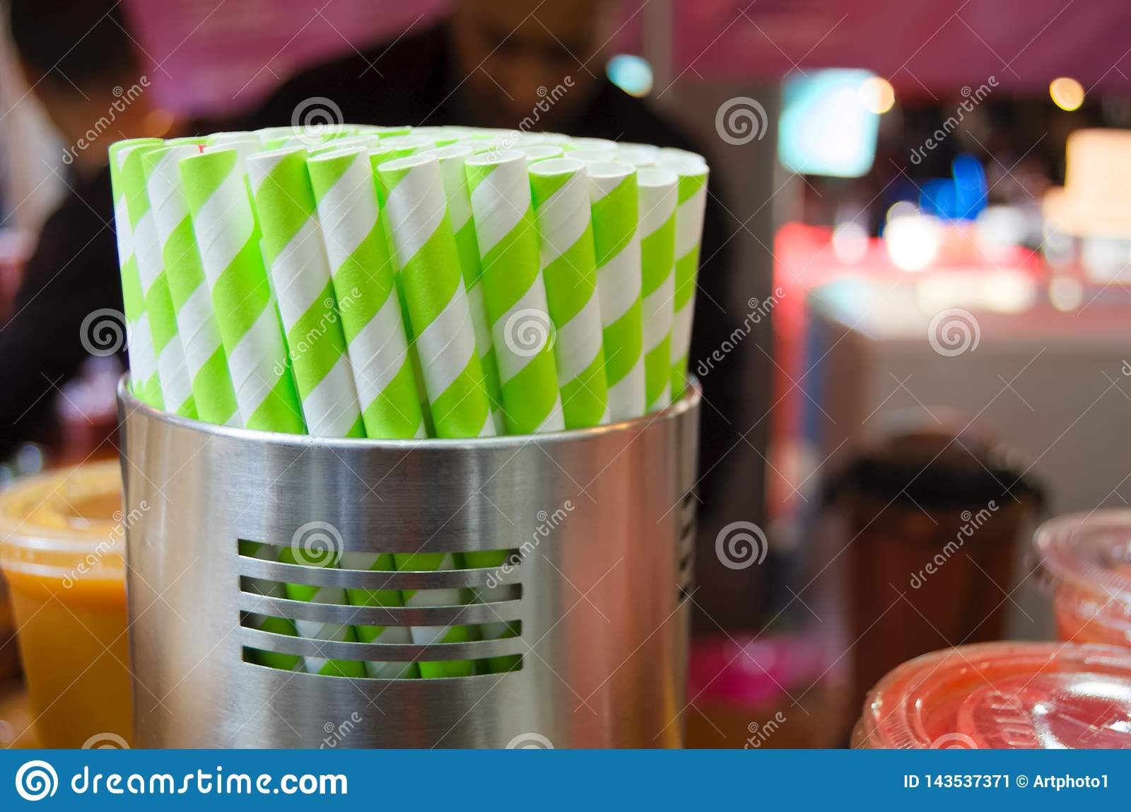Drinking straws in container