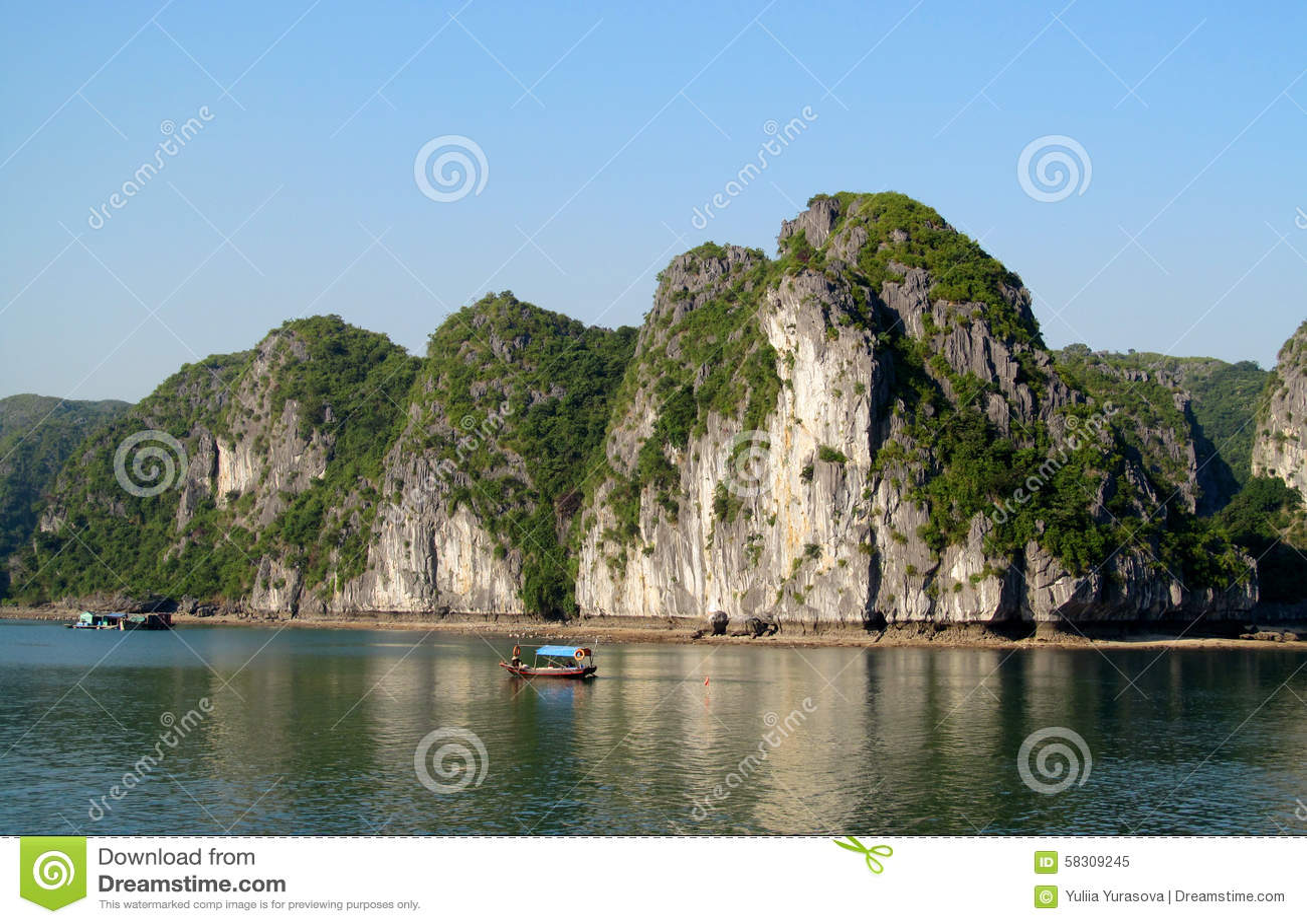 Limestone island and boat in the sea