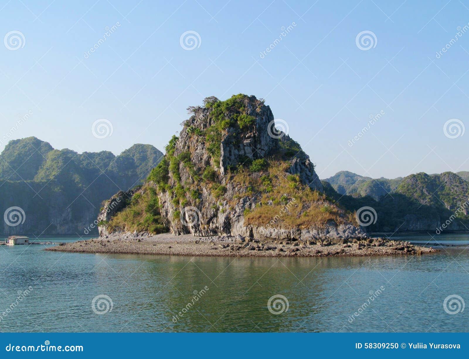 Limestone island in the sea bay