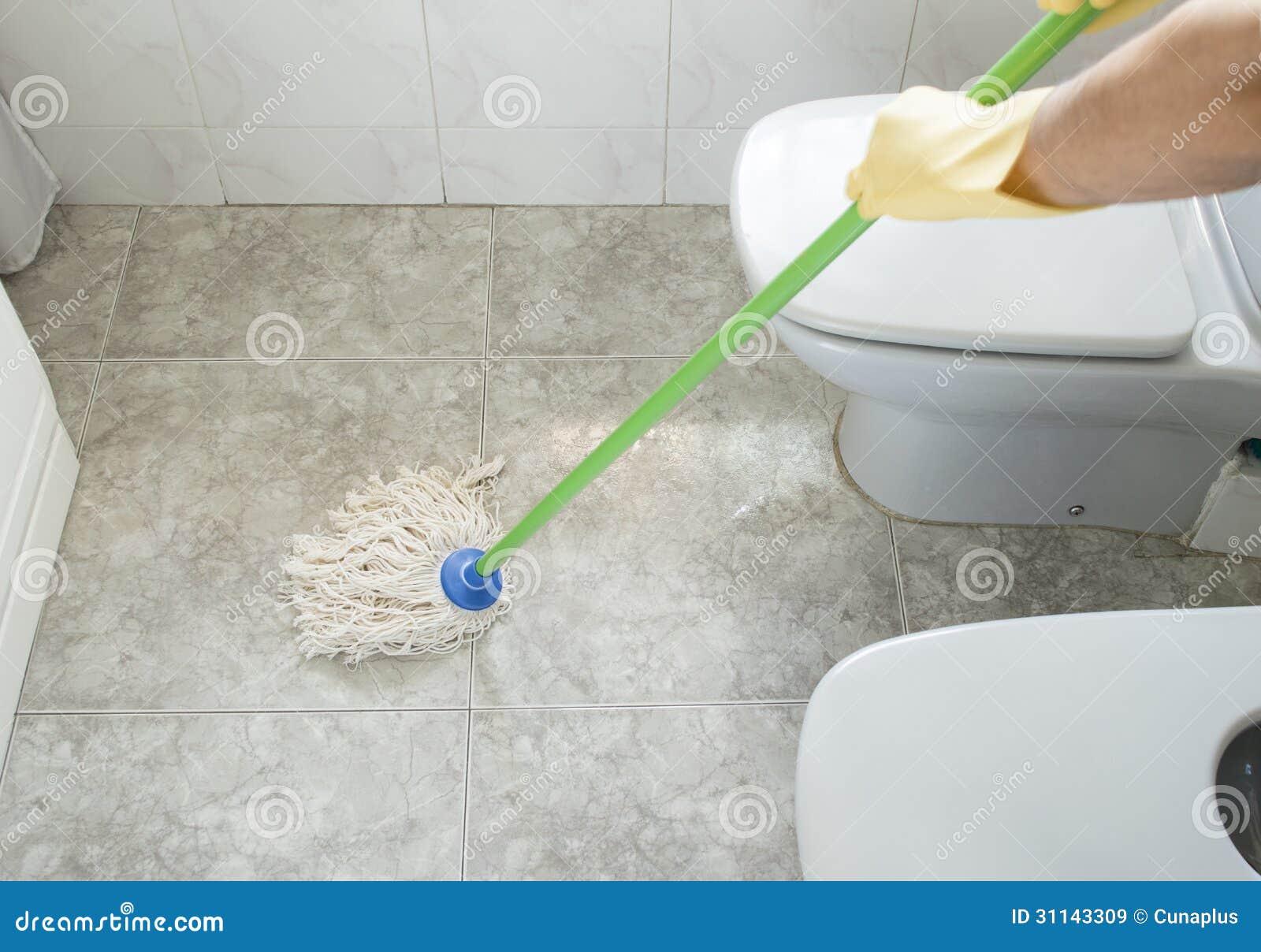 Imagenes De Limpieza Baño:Woman Scrubbing Floor Bathroom