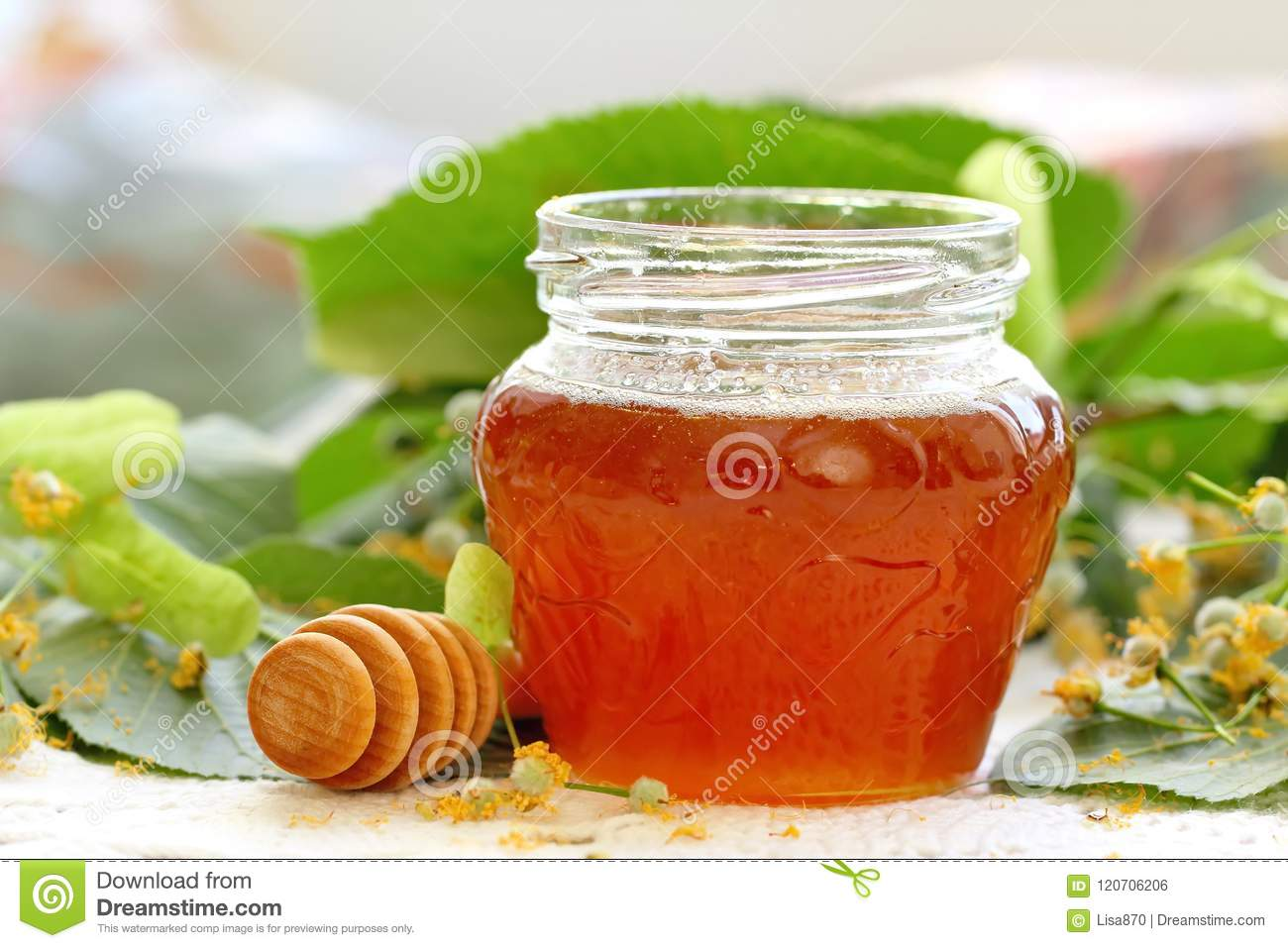Linden honey in glass jar