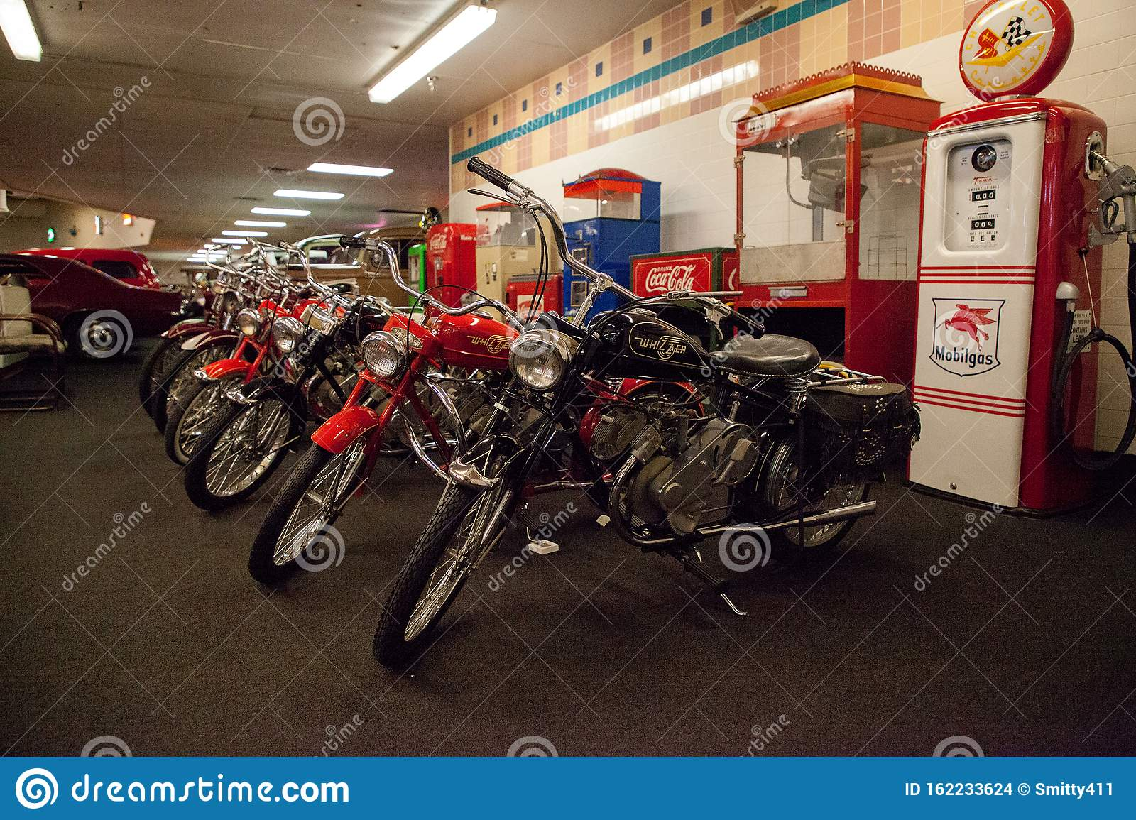 A Line Of Classic Bikes Including Whizzer Displayed At The Muscle Car City Museum Editorial Stock Image Image Of Punta Restoration 162233624