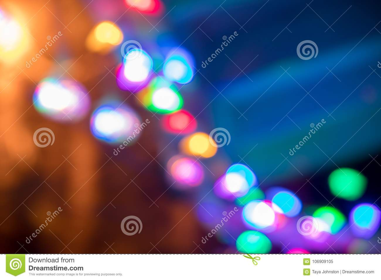 Line Of Colorful Lights Strung Up For Christmas To A